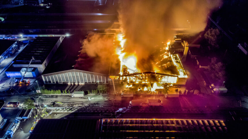 warehouse building on fire in an industrial park